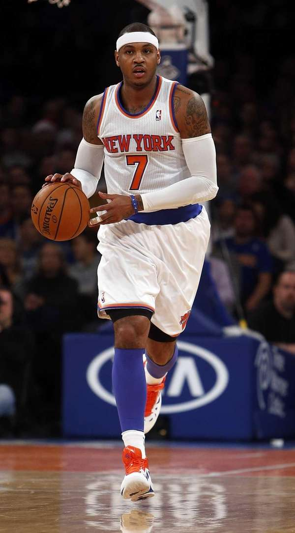 Carmelo Anthony brings the ball up court in