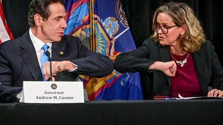 Gov. Andrew Cuomo elbow bumps Nassau County Executive