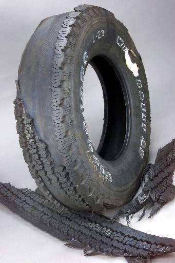 "A 15"" Firestone Wilderness AT tire had a"