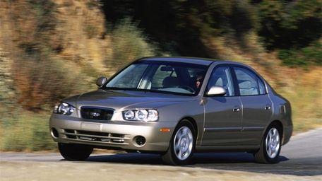 A 2002 Hyundai Elantra GLS is shown.