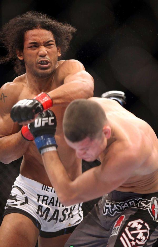 UFC lightweight champion Benson Henderson, left, in action