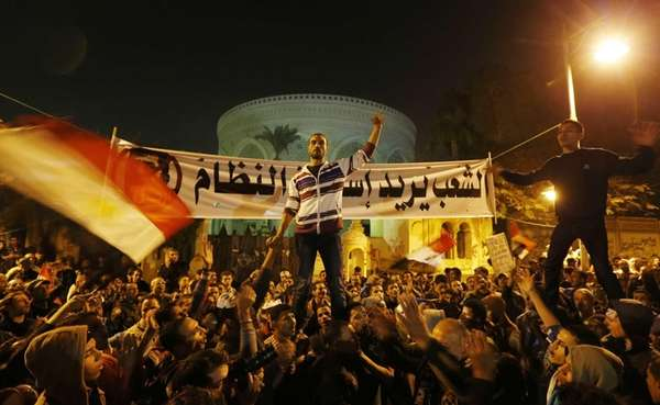 Protesters chant slogans during a demonstration in front