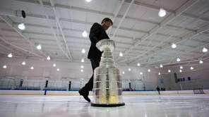 Mike Bolt, keeper of the Stanley Cup, takes