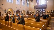 Parishioners during Mass at St. Agnes Cathedral in