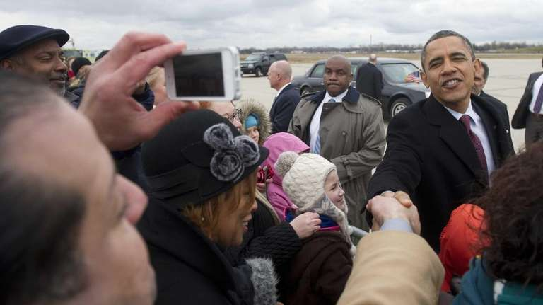 President Barack Obama greets well-wishers after arriving on