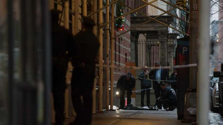 Police investigate the crime scene where a man