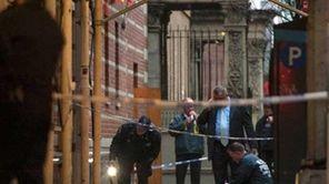 Police investigate the crime scene on 58th street