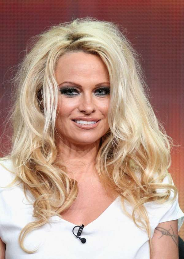 Pamela Anderson speaks onstage at the quot;Dancing with