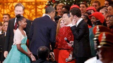 President Barack Obama shakes hands with South Korean