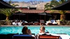 Patrons sit poolside at Sparrows Lodge in Palm
