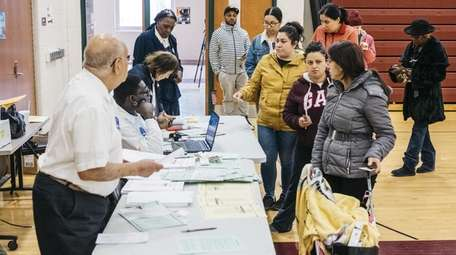 Voters check in at a polling site for