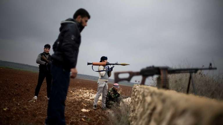 Free Syrian Army fighters take their positions, close