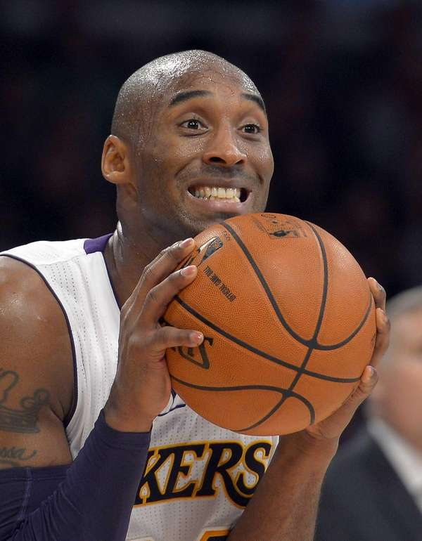 Los Angeles Lakers guard Kobe Bryant reacts to
