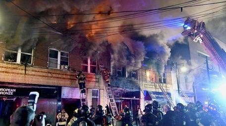 Firefighters battle a blaze on Main Street in
