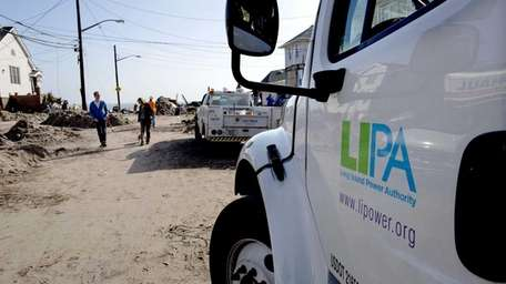 A Long Island Power Authority truck is among