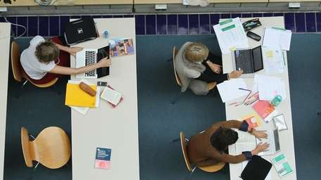 Students study with their laptop computers in in