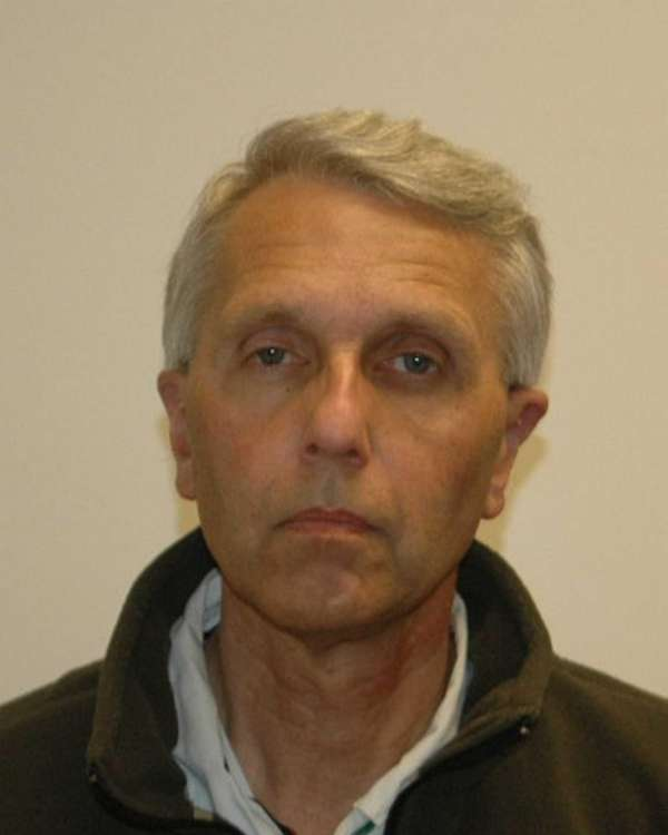 John Rom, 57, of Roslyn Heights, was arrested