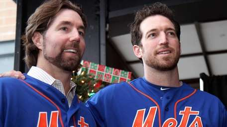 The Mets' R.A. Dickey and Ike Davis treat