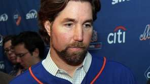 R.A. Dickey exits after treating 100 Queens school