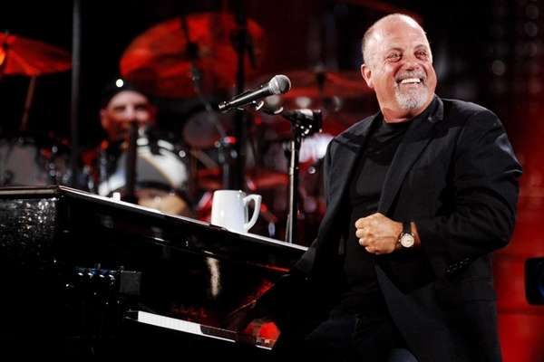 Billy Joel performs at Shea Stadium.