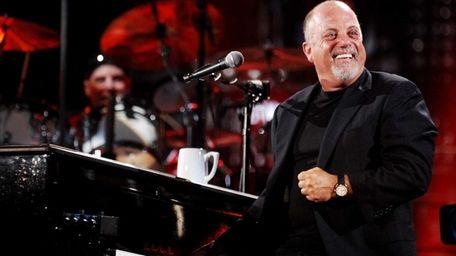 Billy Joel performs at Shea Stadium.