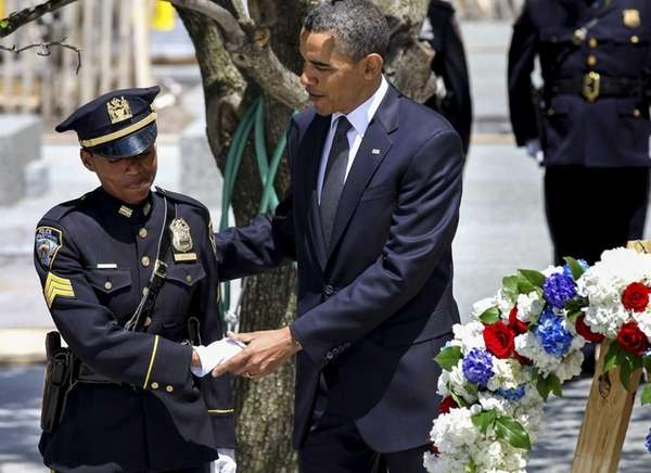 President Barack Obama comforts Sgt. Stephanie Moses after