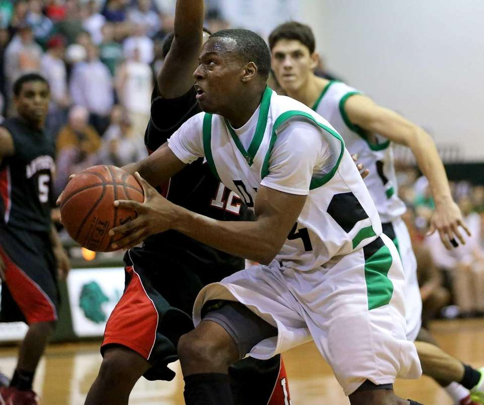 Farmingdale's Dalique Mingo drives past Lutheran's Tim Quashie.