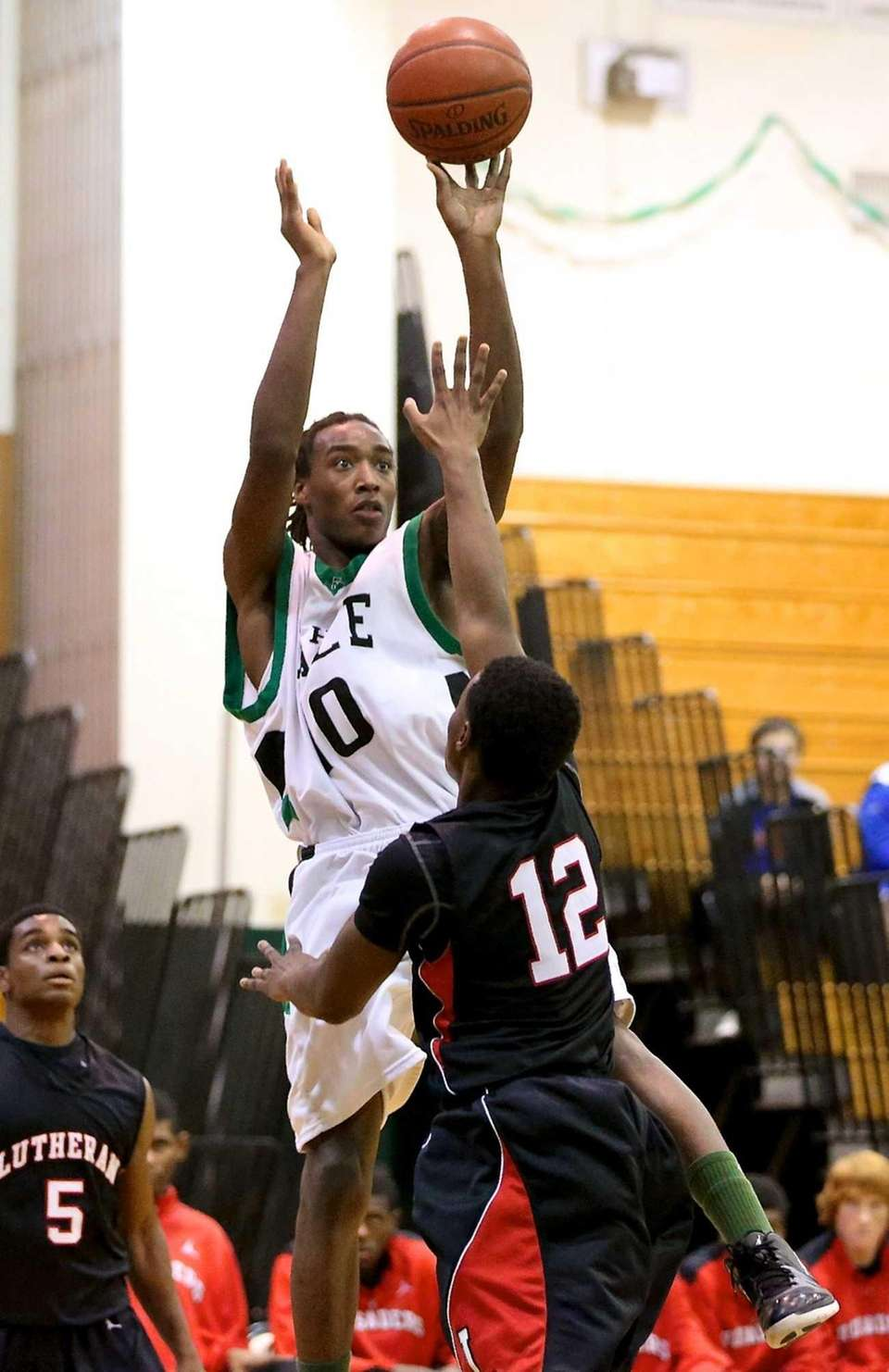 Farmingdale's Curtis Jenkins puts a shot up as