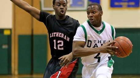 Farmindale's Dalique Mingo drives past Lutheran's Tim Quashie.