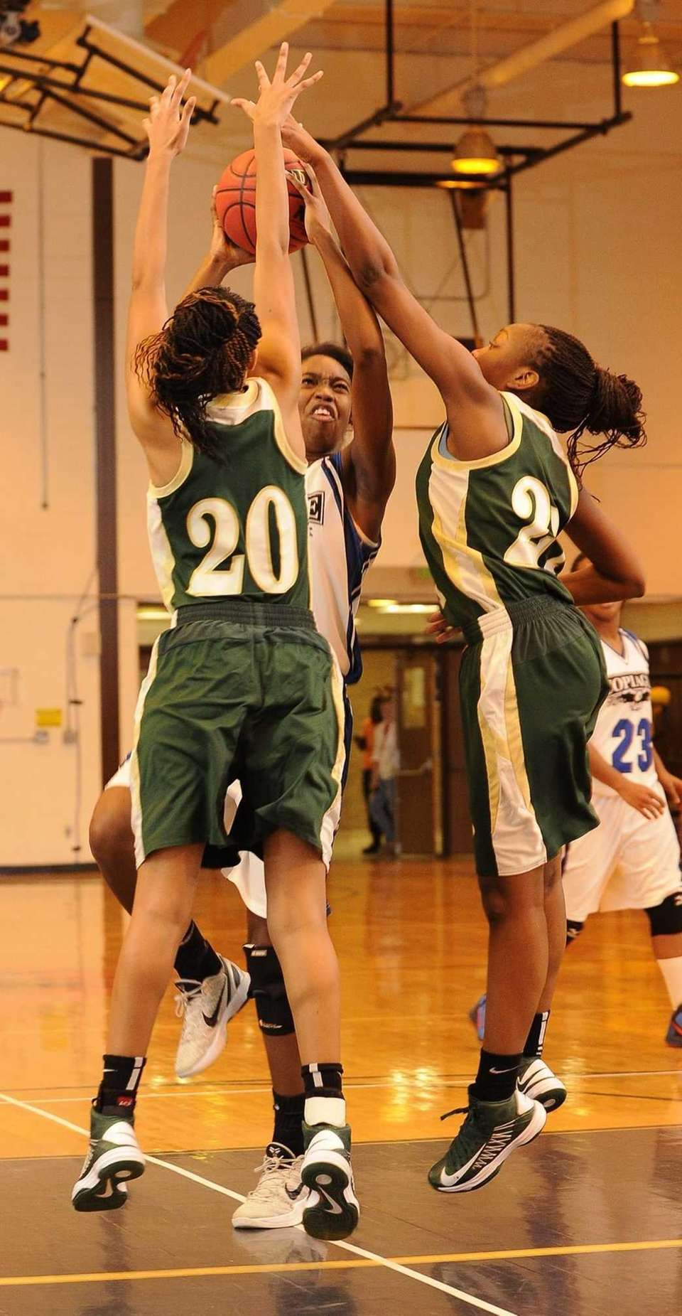 Copiague's Mikaiya Moore draws a foul defended by