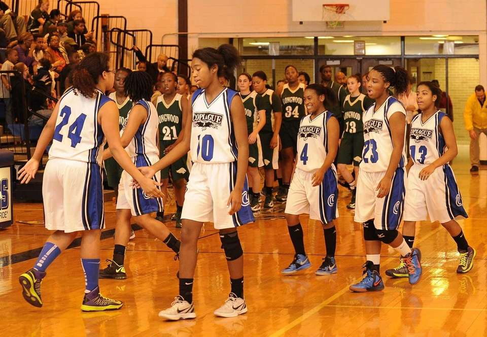 Copiague's Mikaiya Moore and her teammates leave the