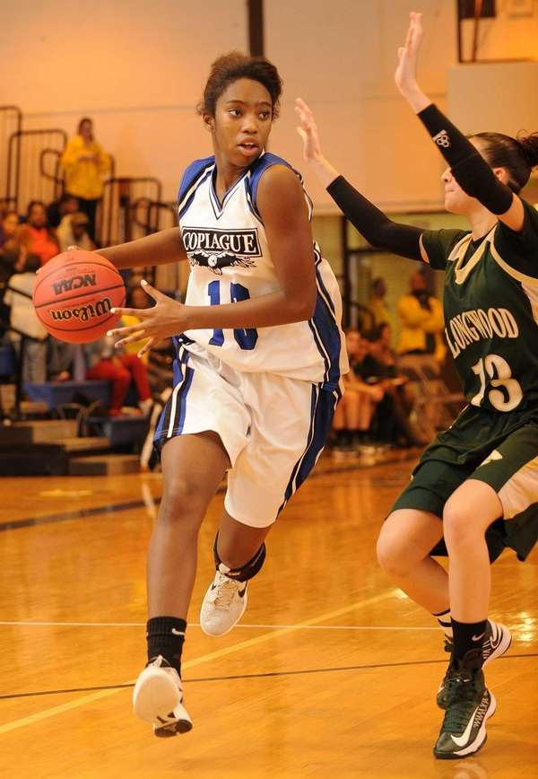 Copiague's Mikaiya Moore drives to the basket defended