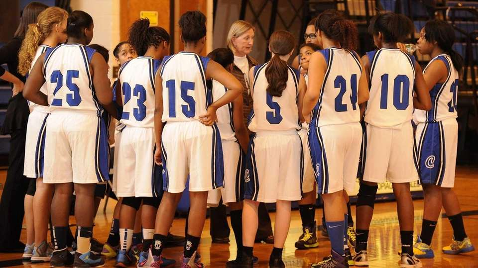 Copiague coach Carole Olsen talks to her players