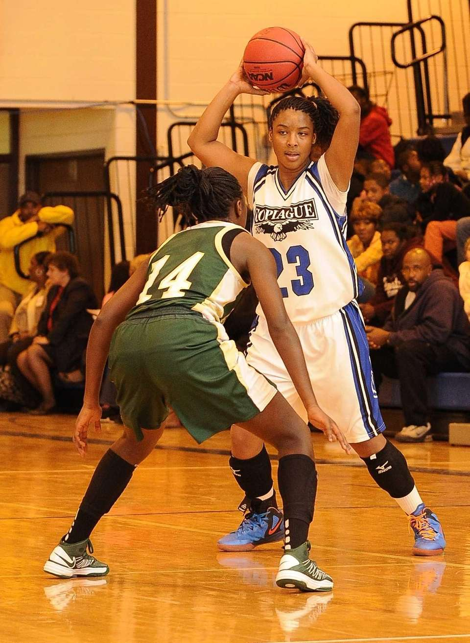 Copiague's I'Asia O'Garro is defended by Longwood's Kiersten