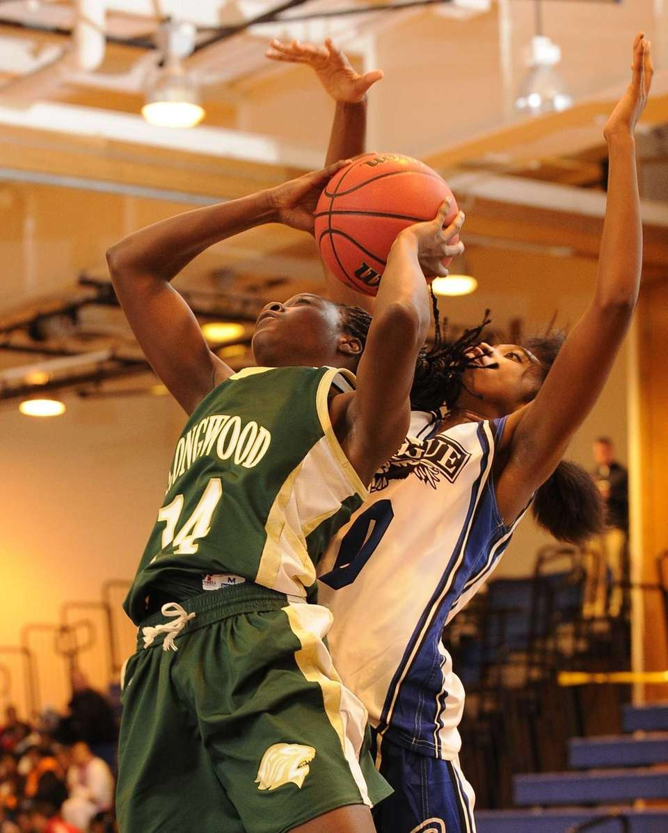 Longwood's Kiersten West shoots defended by Copiague's Mikaiya