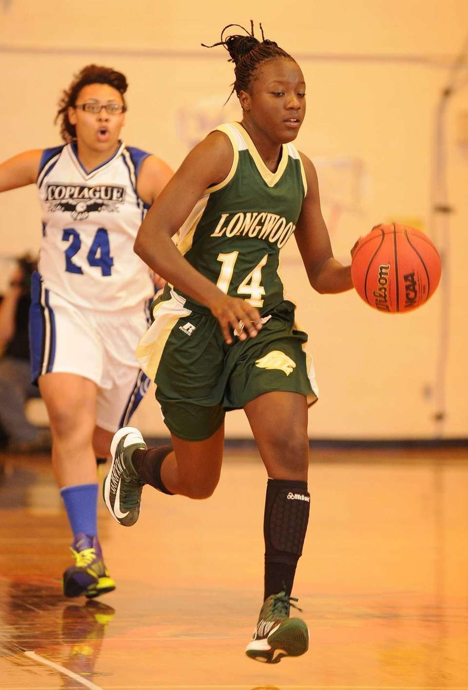 Longwood's Kiersten West drives the ball against Copiague