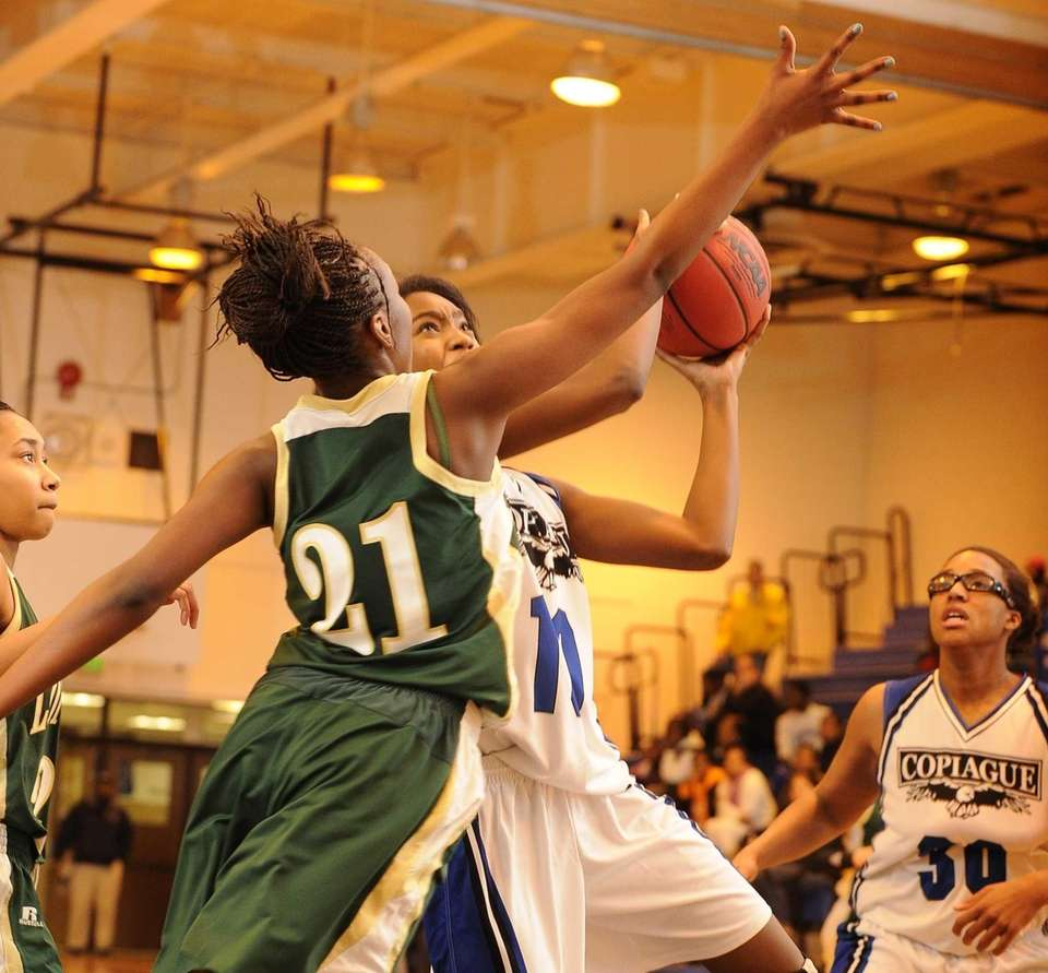 Copiague's Mikaiya Moore is fouled by Longwood's D.