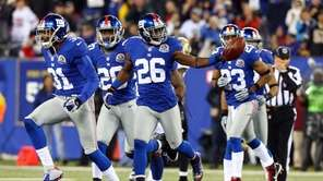 Antrel Rolle celebrates his fumble recovery during a