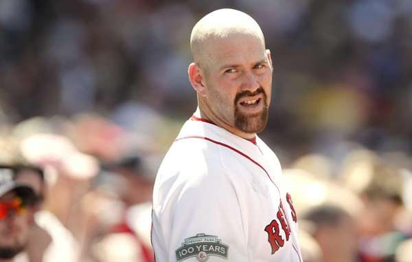 Kevin Youkilis looks on from the dugout during