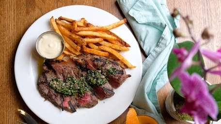 Steak frites with salsa verde, crispy fries and