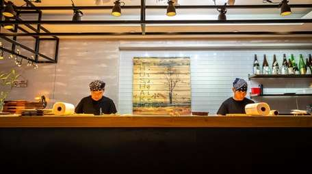 Chefs and line cooks work during a weekday