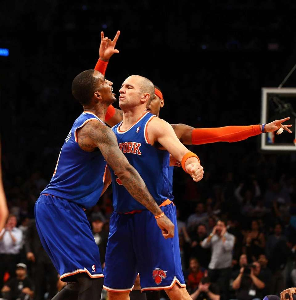 Jason Kidd celebrates his game-winning 3-pointer with J.R.