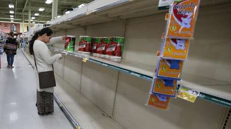 Shelves were emptied of paper goods at a