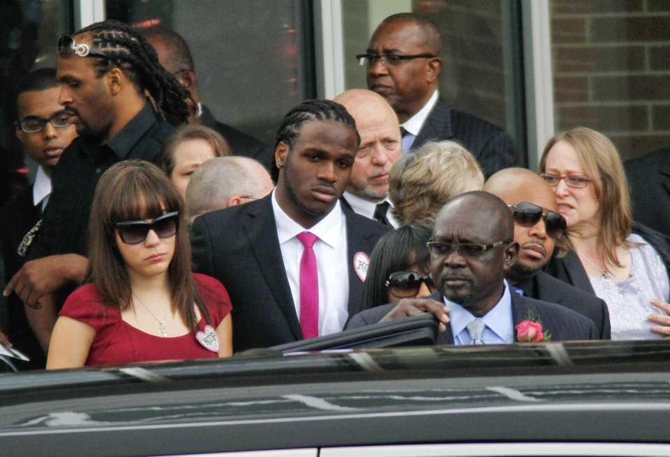 Kansas City Chiefs player Jamaal Charles, center, and