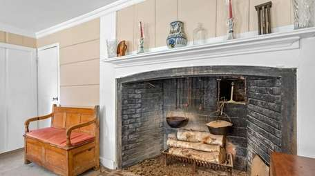 It features a central chimney and a fireplace