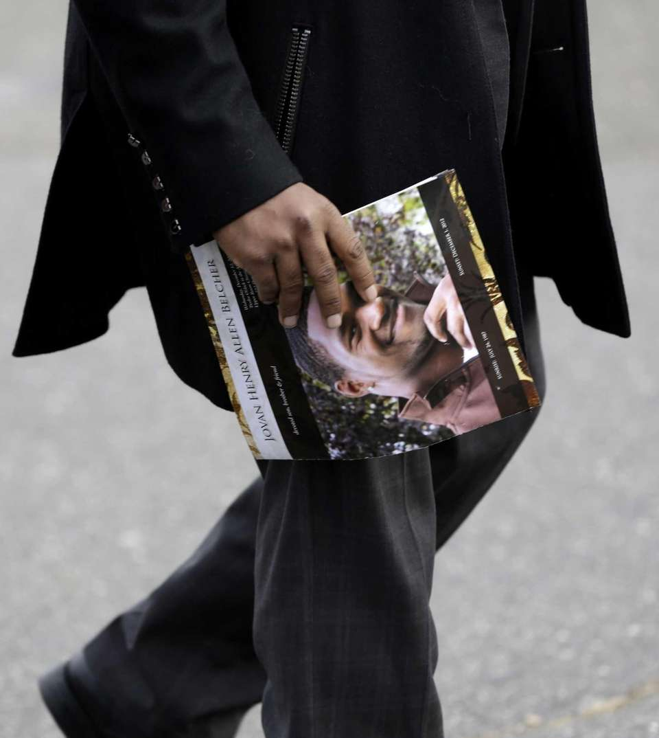 A man carries a program with a photo