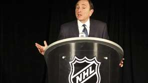 NHL commissioner Gary Bettman speaks to reporters after