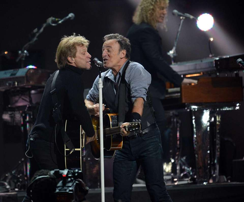 Jon Bon Jovi, left, and Bruce Springsteen perform
