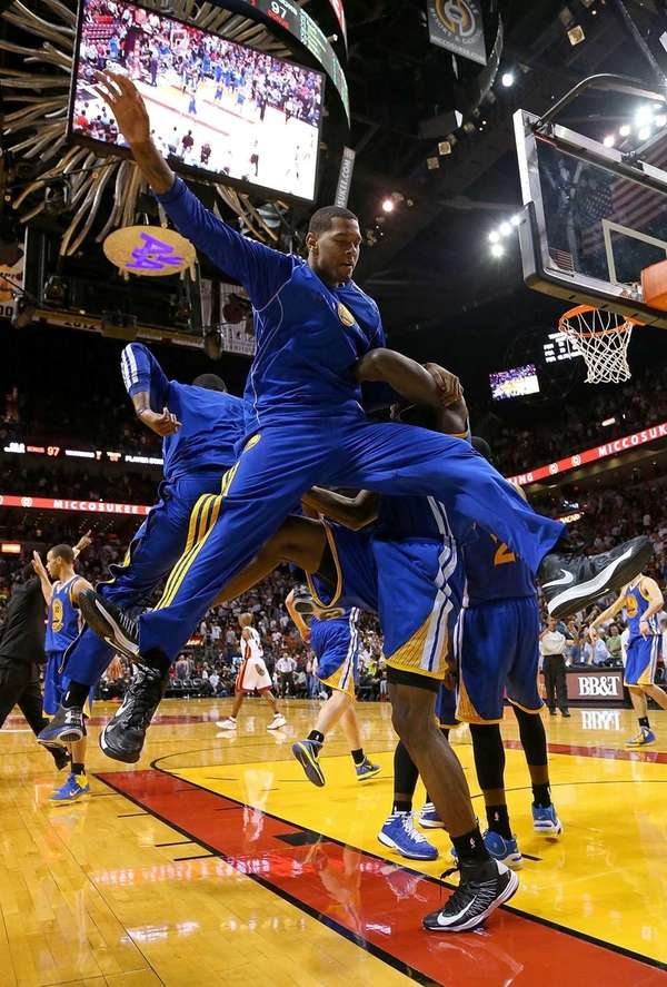 The Golden State Warriors celebrate after winning a
