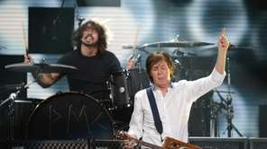 Paul McCartney performs at the 12-12-12 concert benefiting
